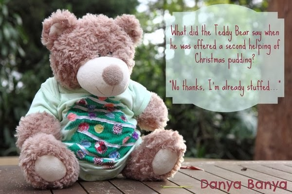 Teddy Bear wearing Christmas onesie (plus joke)