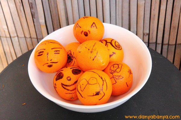 Orange faces! A bowl of oranges with faces drawn on