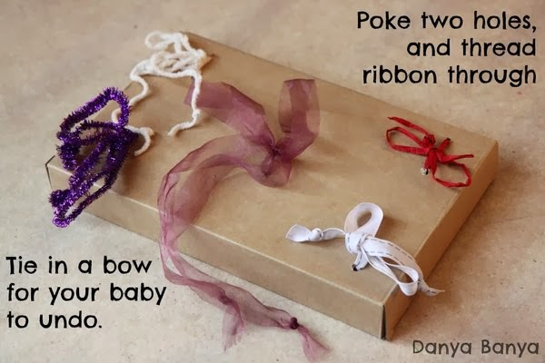 baby toy with ribbons