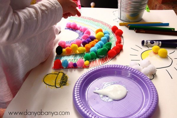 Pasting pom poms onto a rainbow - colour matching and fine motor skill practice for toddlers and preschoolers