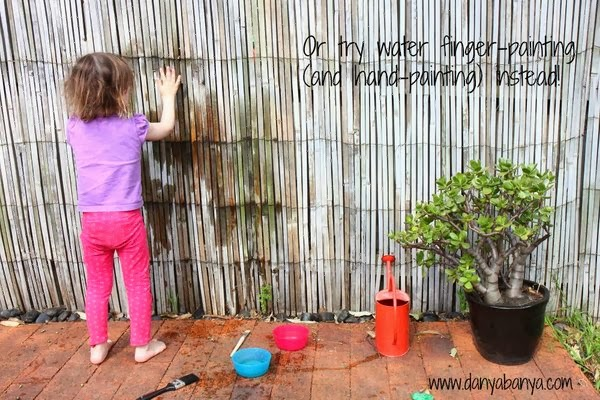 Mess-free toddler play idea: finger-painting (and hand-painting) with water