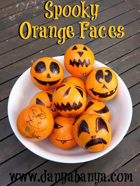 Spooky Orange Faces - healthy fruit snack for Halloween
