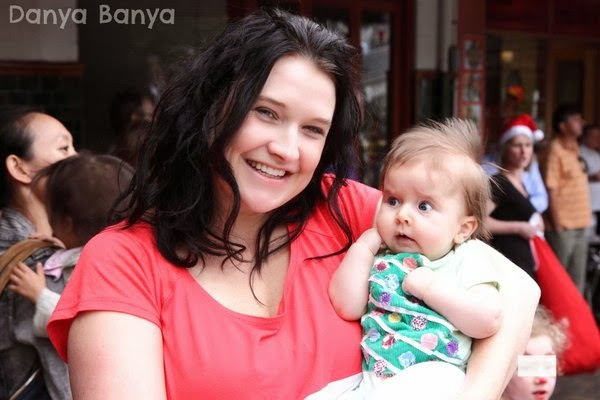 Danya Banya holding 3 month old baby Bee wearing Christmas onesie