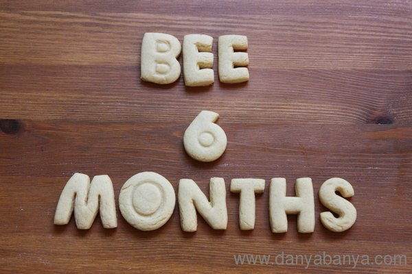 Bee 6 months, written in cookie letters
