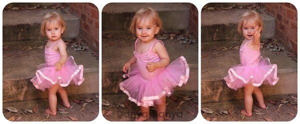 Fourteen month old toddler dressed as a ballerina in pink tutu