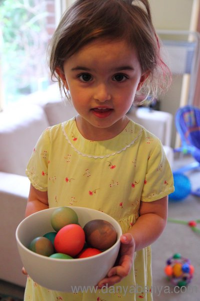 Girl with bowl of coloured eggs