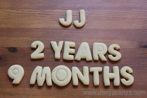 JJ 2 years 9 months written in cookie letters