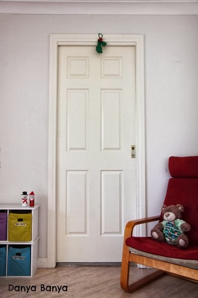 DIY kids footprint mistletoe hanging above door
