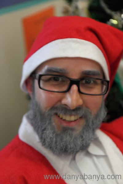 Mr Banya dressed as Santa with white hairspray on his beard