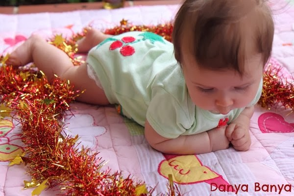 3 month old baby doing tummy time