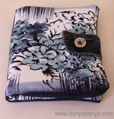 Upcycled Kindle cover in denim + floral blue fabric with jeans button