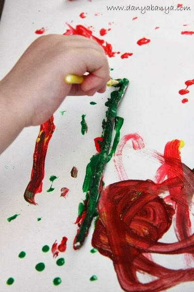 Toddler art idea: Painting on sticks