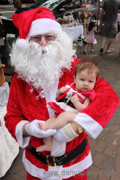 Santa holding baby Bee in her Mrs Claus outfit