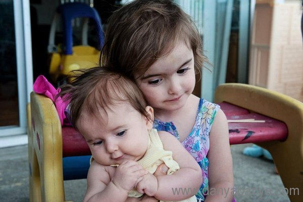 Sisters - Girl and baby